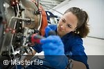 Female mechanic repairing part